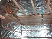 Sauna room has foil on the ceiling and walls, and we started attaching the cedar paneling to the ceiling