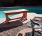 Cedar bench by pool in Phoenix