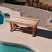 Cedar bench by pool walkway