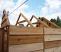 Sauna roof mounted on larger sauna