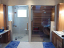 Back to back sauna and steam room shown in lower light