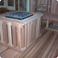 Sauna heater mounted in middle of sauna