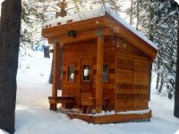 Outdoor mountain sauna in the snow